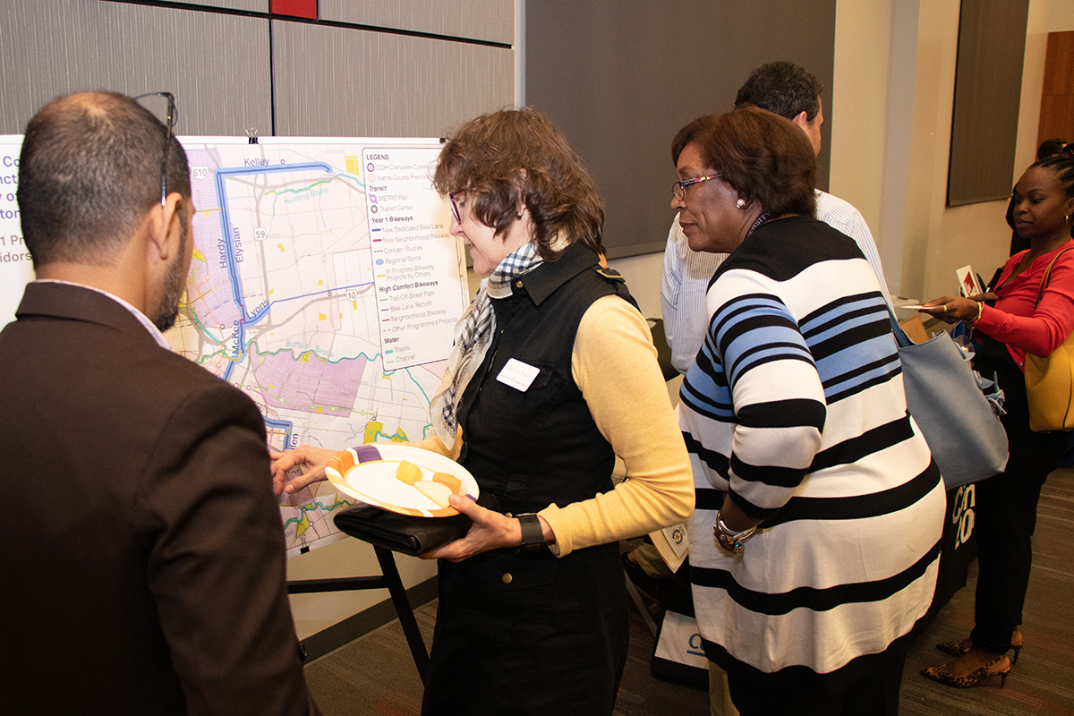 Precinct One residents reviewing plans at a Flood Bond community engagement meeting