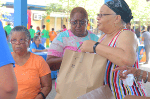 Families purchasing food at a farmers market
