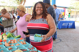Woman buying vegetables at a farmers market