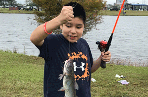 Child holding a fish they caught