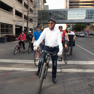 Commissioner Ellis biking with the community